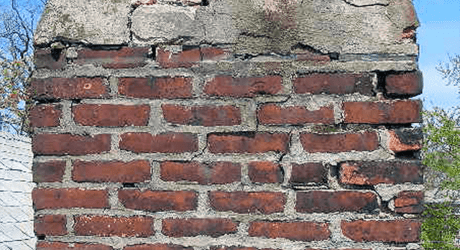 A chimney cracking due to weather over years. Vortex can fix your cracked chimney!